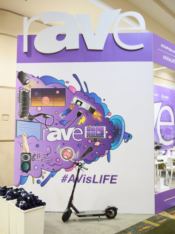 An electric scooter parks right in front of the rAVe #AVisLIFE mural